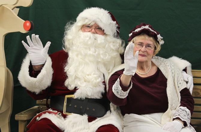 Santa and Mrs. Claus waving